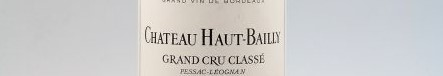 The picture shows a grand cru bottle of Chateau Haut Bailly wine from Bordeaux