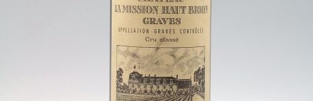 The picture shows a grand cru bottle of Chateau Mission Haut Brion wine from Bordeaux