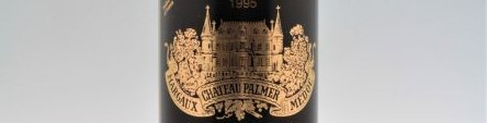 The picture shows a grand cru bottle of Chateau Palmer wine from Bordeaux