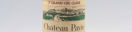 The picture shows a grand cru bottle of Chateau Pavie wine from Bordeaux