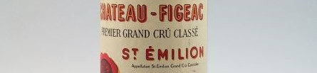 The picture shows a grand cru bottle of Figeac wine from Bordeaux