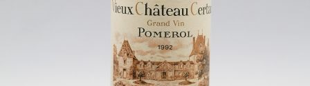 The picture shows a grand cru bottle of Chateau Vieux Chateau Certan wine from Bordeaux