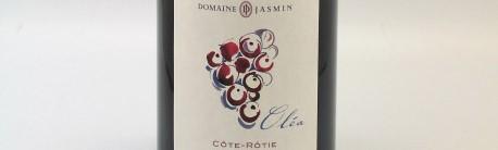 La photo montre une bouteille de vin du domaine Jasmin dans le Rhone