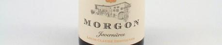 La photo montre une bouteille de vin du domaine Louis Claude Desvignes dans le Beaujolais