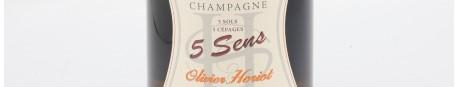 La photo montre une bouteille de Champagne du domaine Olivier Horiot dans la Champagne
