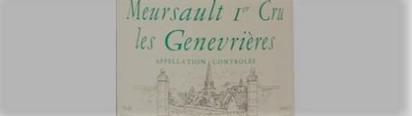 La photo montre une bouteille de vin MEURSAULT 1er cru genevrieres du Domaine de remi jobard situé à meursault en Bourgogne