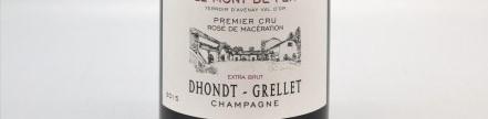 La photo montre une bouteille de champagne du domaine Dhondt Grellet en Champagne