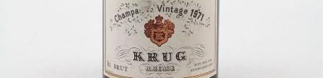 La photo montre une bouteille du grand Champagne de la Maison Krug