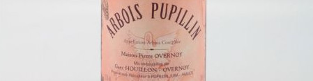 The picture shows a bottle of Arbois wine from domaine pierre overnoy from Jura.