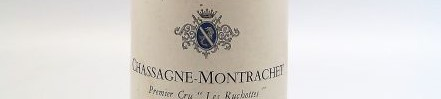 the picture shows a bottle of Chassagne Montrachet wine, Burgundy
