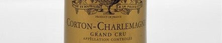 the picture shows a bottle of Corton Charlemagne wine, Burgundy
